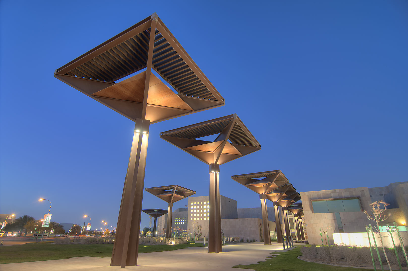Lampposts of Student Center in Education City campus, at evening. Doha, Qatar