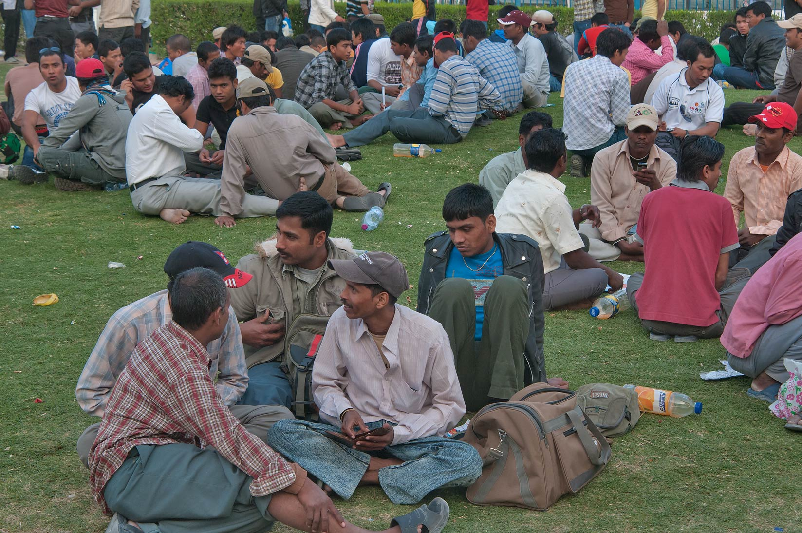Migrant workers socializing near Central Bus...Ghanim on Friday evening. Doha, Qatar