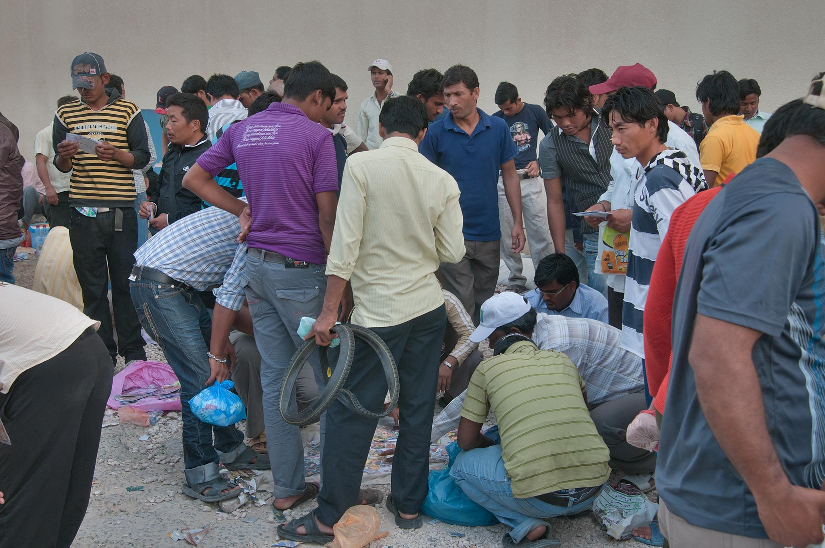 Migrant workers at flea market near Central Bus Station Al Ghanim on Friday. Doha, Qatar