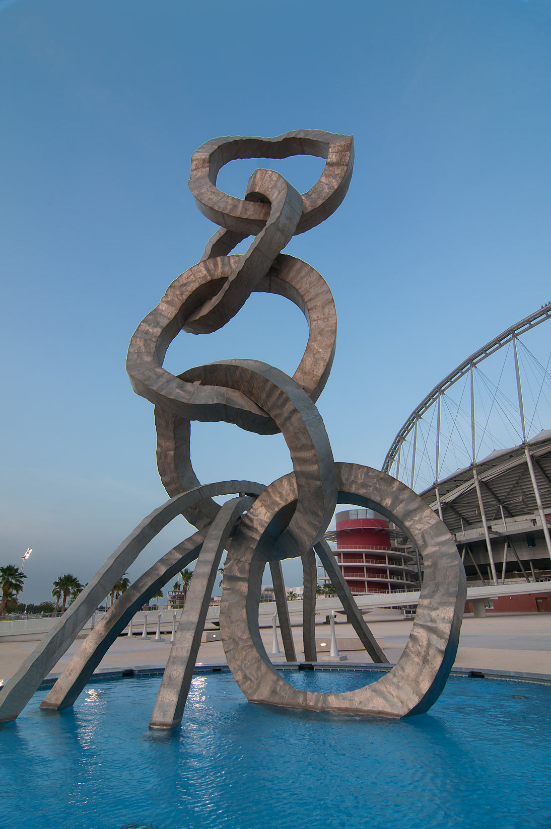 Olympic rings sculpture by Ahmed Al Bahrani in...a stadium in Aspire Zone. Doha, Qatar