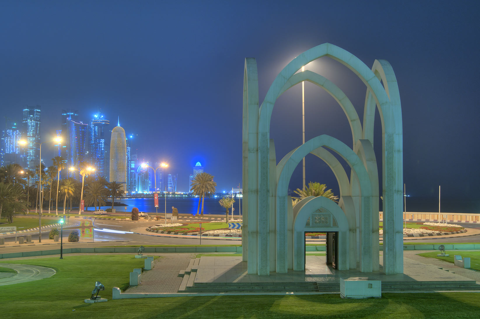 The arch of Rumeilah (Al Bidda) Park, with West Bay in background. Doha, Qatar