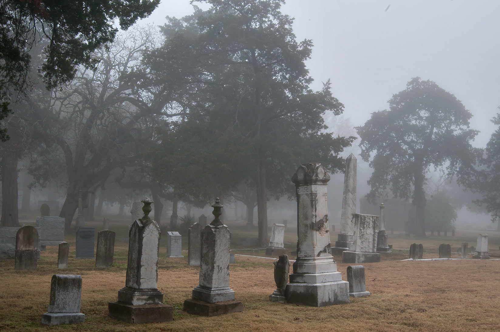 Tombs of City Cemetery in fog. Bryan, Texas