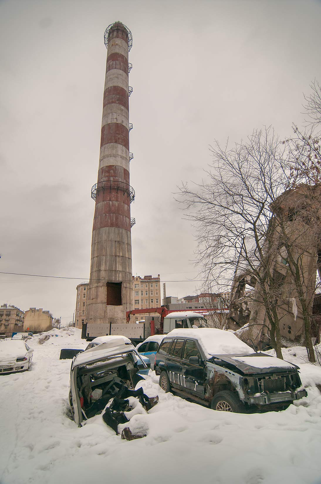 Smokestack of Krasnoe Znamia Factory on...neighborhood. St.Petersburg, Russia