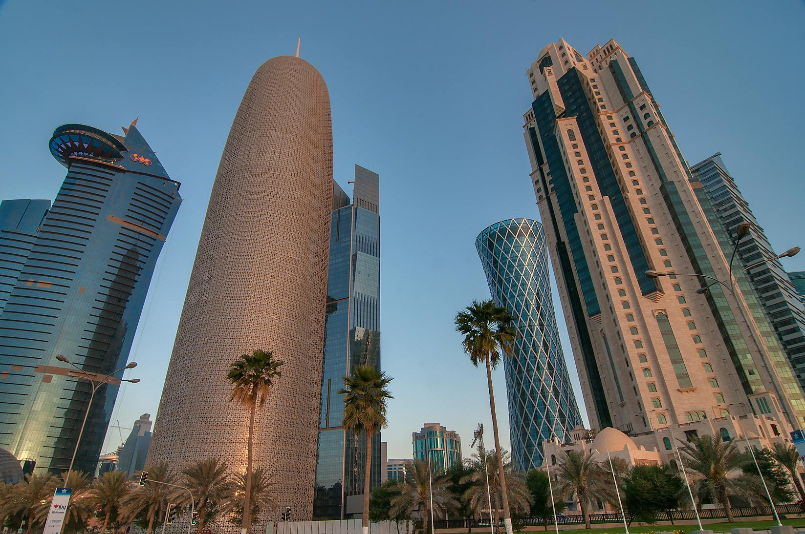 Area of Burj Qatar Tower in West Bay from Corniche at sunrise. Doha, Qatar