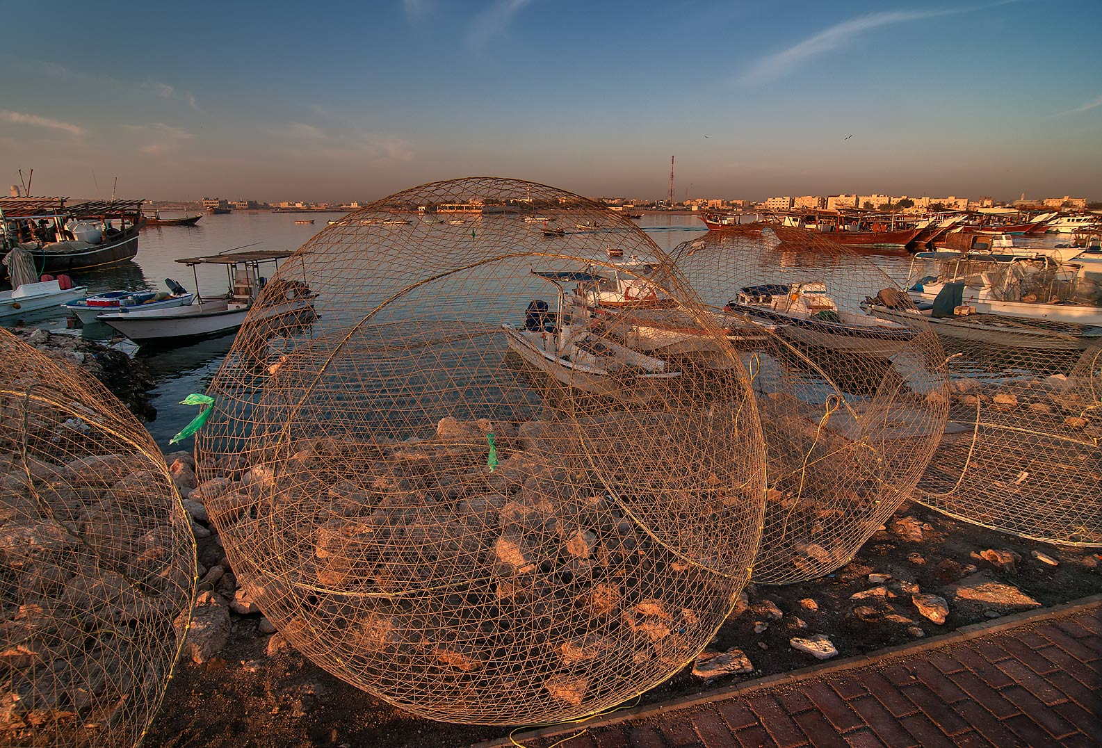 Domed wire fish traps (gargoor) in pier in Al Wakra at sunrise. Qatar