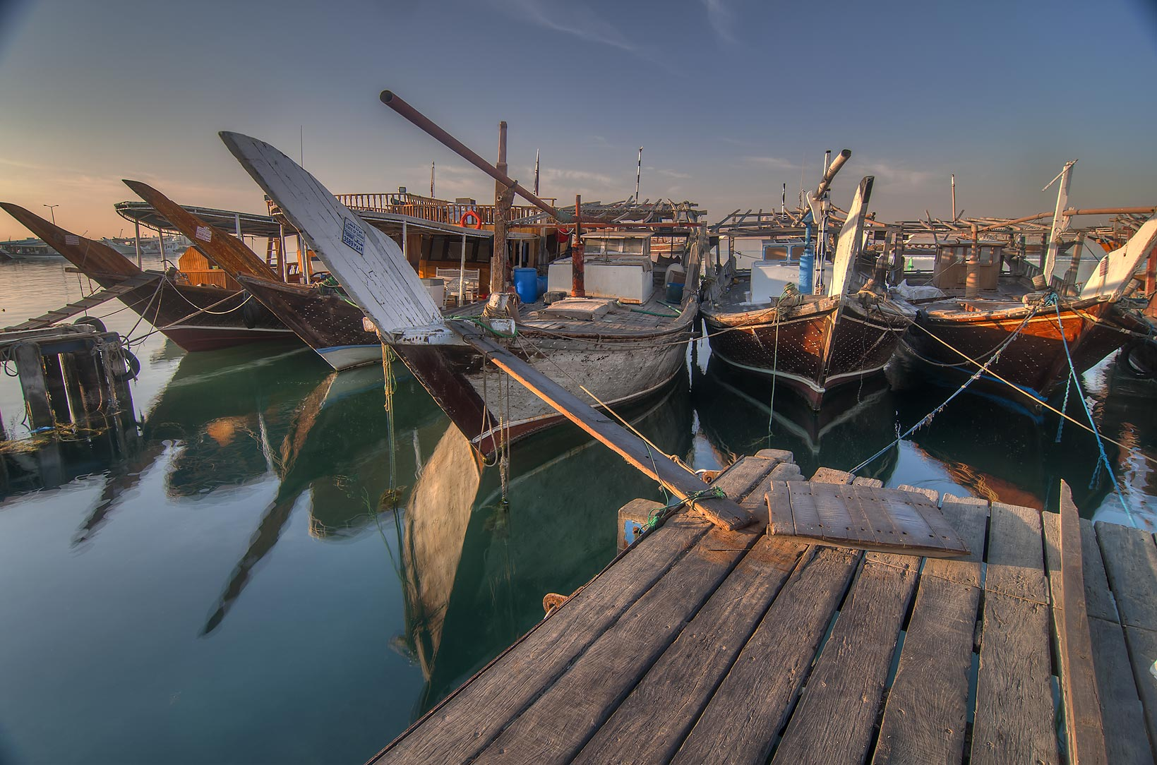 Five dhow fishing boats on a pier in Al Wakra. Qatar