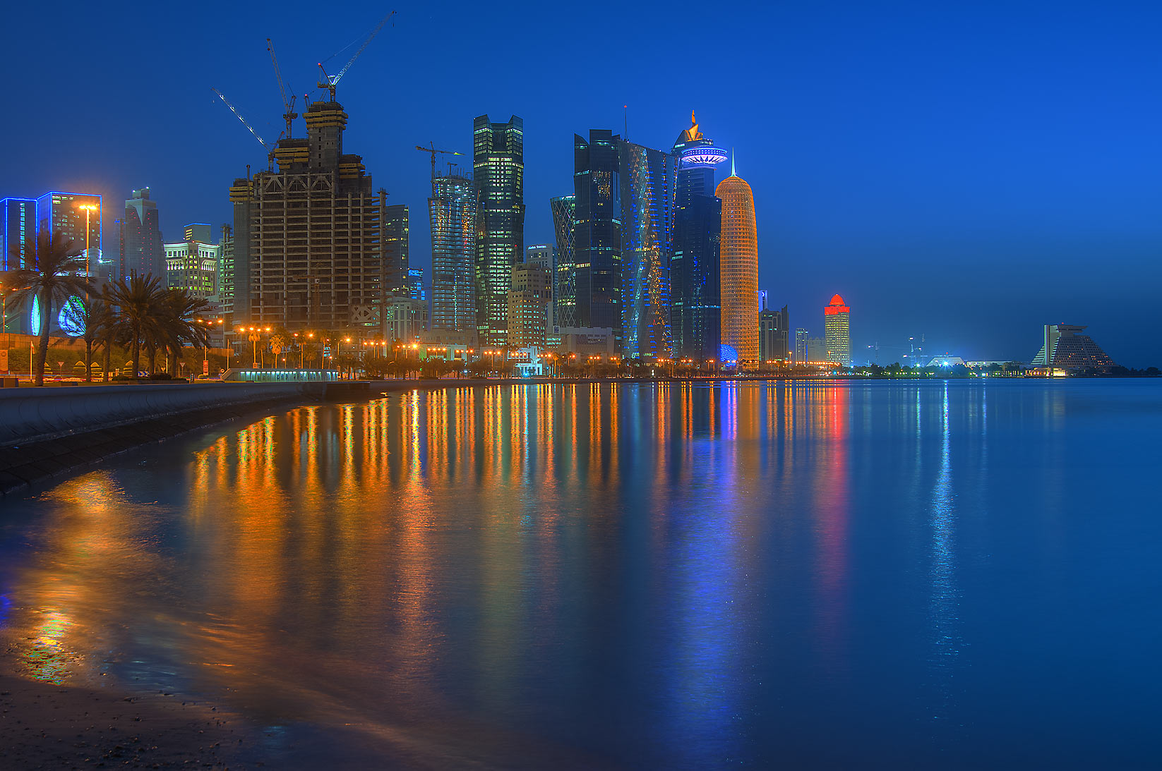 West Bay area from Corniche promenade near Al Bidda Park at morning dusk. Doha, Qatar