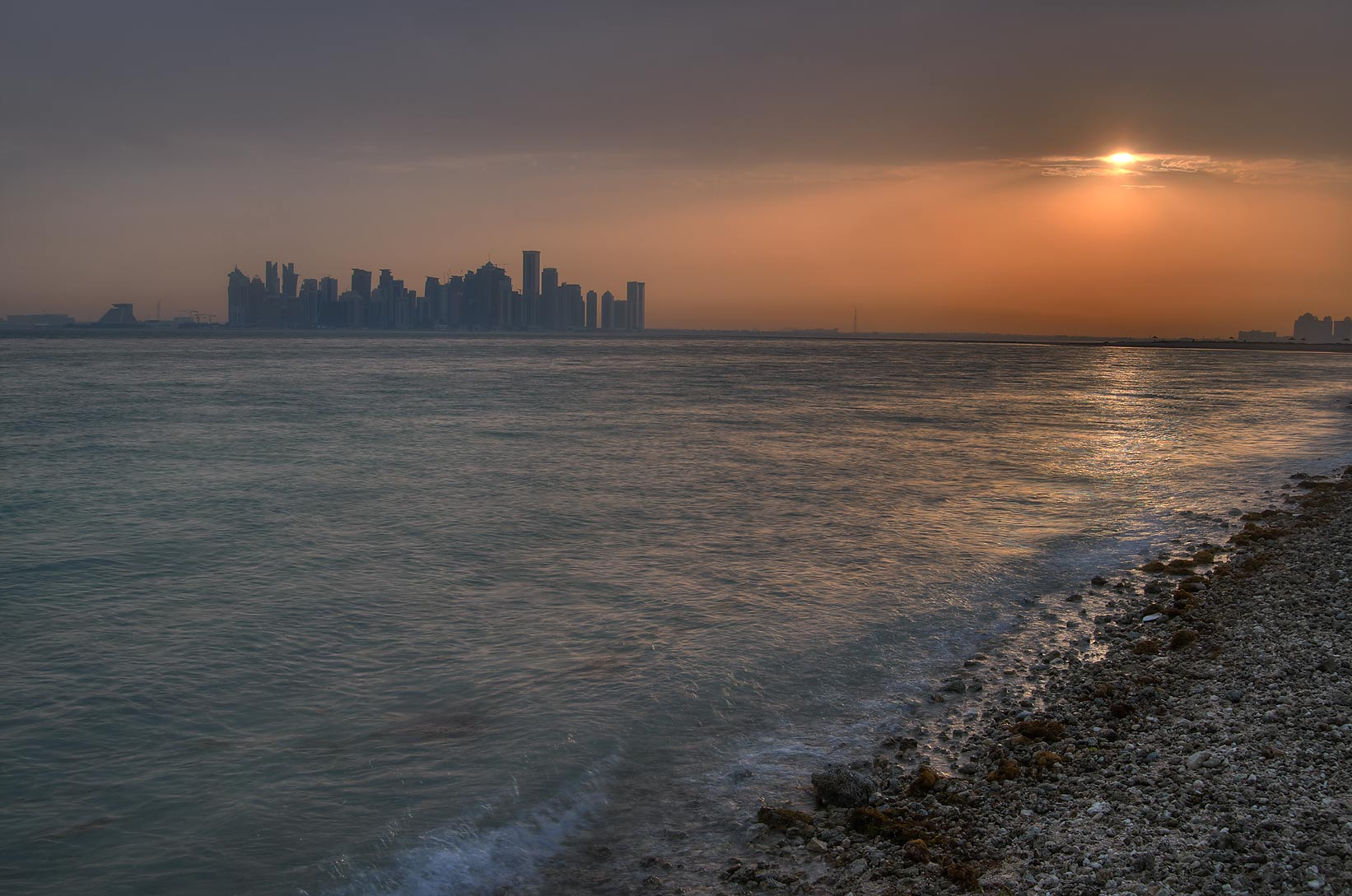 Sunset from Safliya Island near Doha, with West Bay in background. Qatar