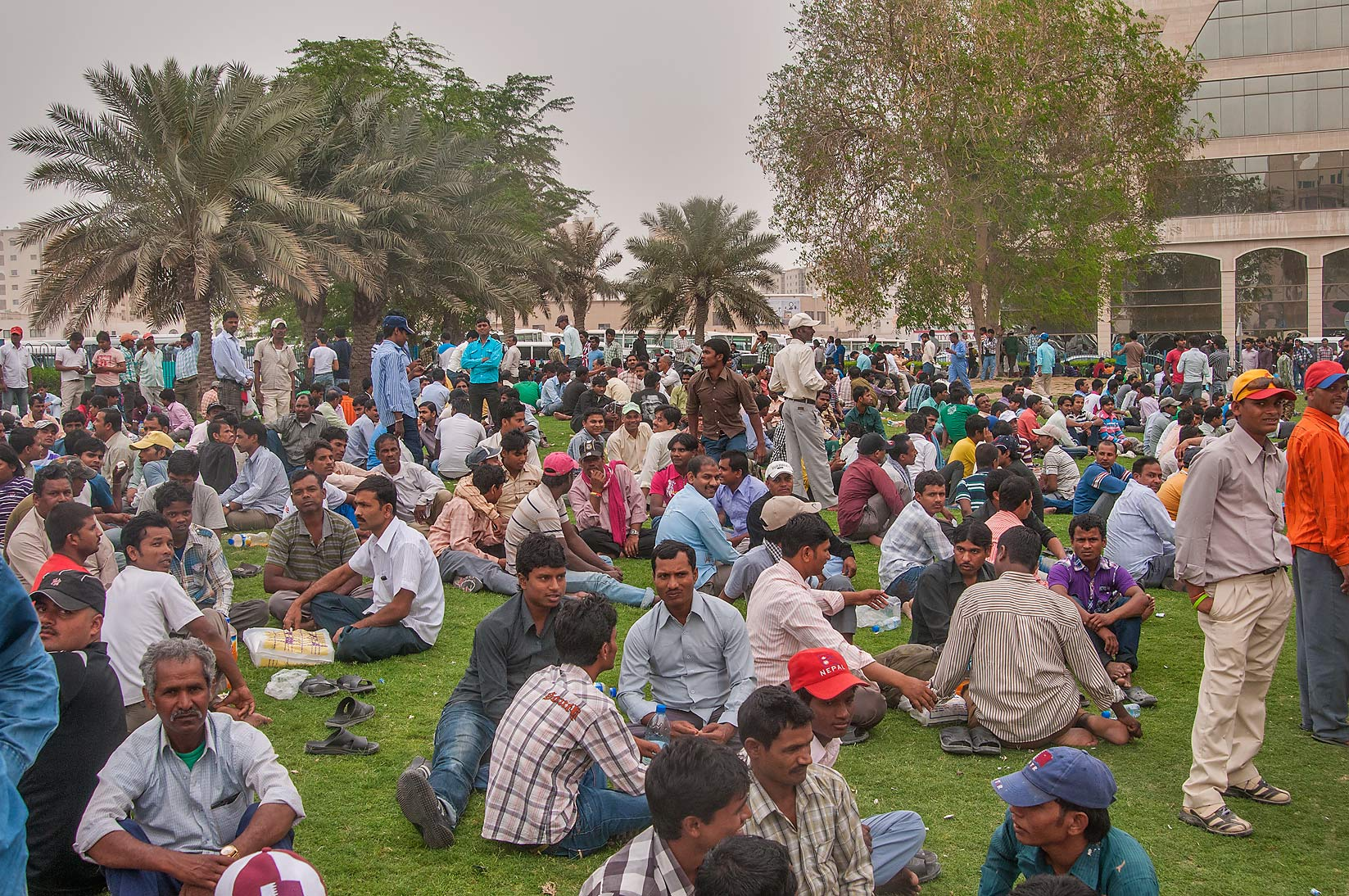 Friday gathering of migrant workers on a lawn...Bus Station Al Ghanim. Doha, Qatar