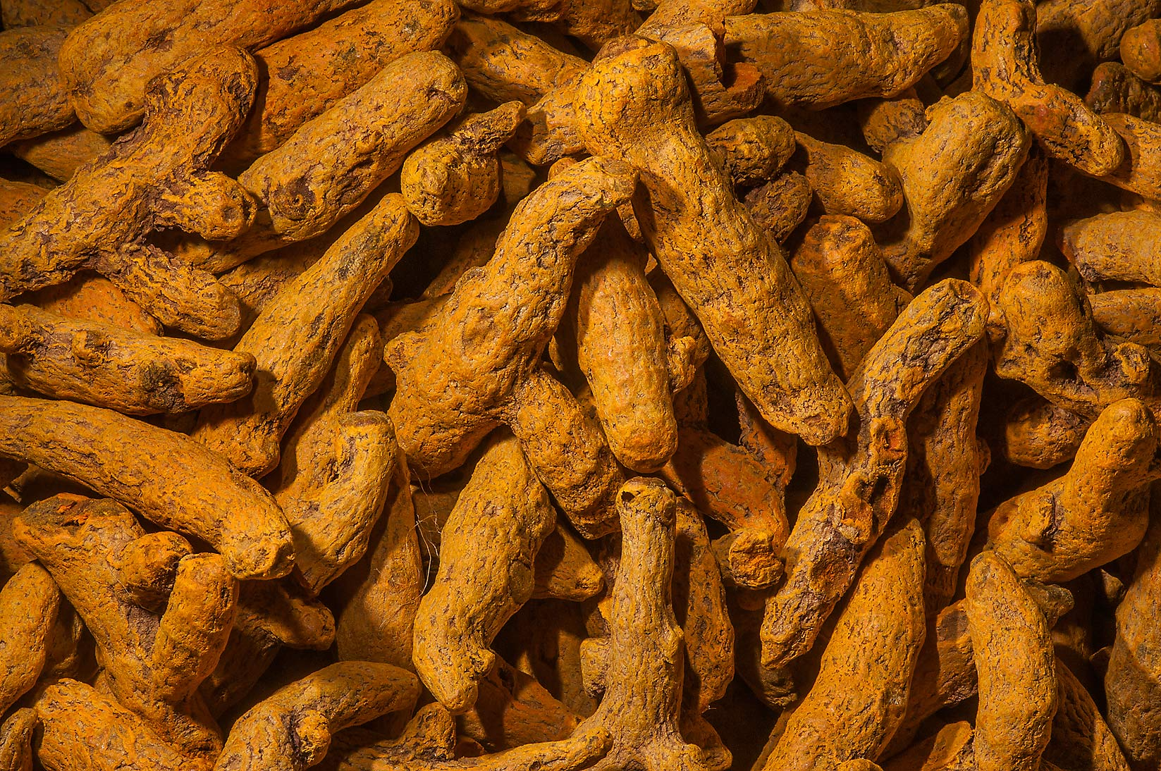 Yellow sulphuric roots (turmeric, yellowish-brown...Souq Waqif (Old Market). Doha, Qatar