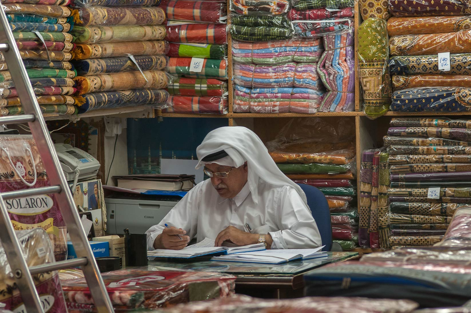 Keeper in a fabric shop in Souq Waqif (Old Market). Doha, Qatar