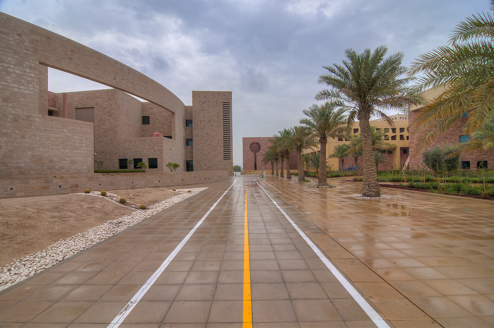 Bicycle path between Carnegie Mellon and Texas A...in Education City at rain. Doha, Qatar