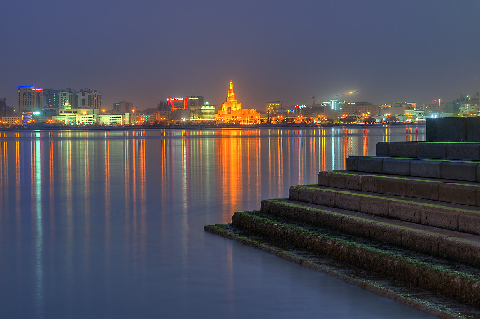 Reflections of Spiral Mosque from Corniche...low tide at morning dusk. Doha, Qatar