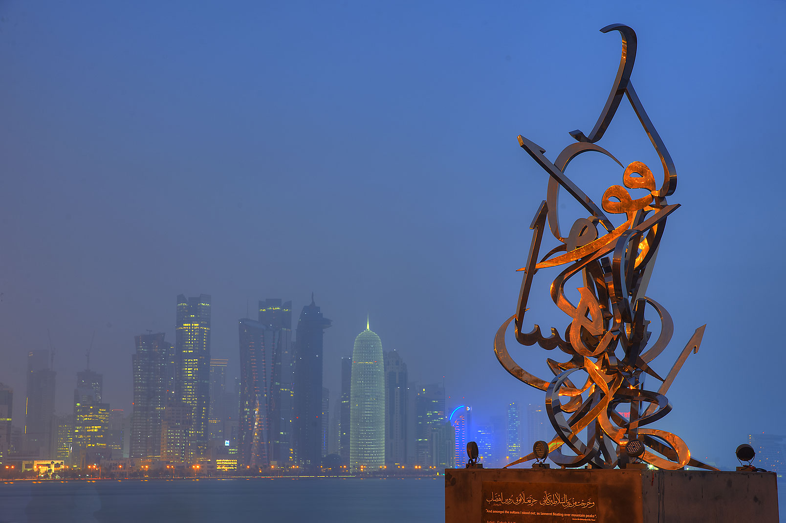 Calligraphy Sculpture by Sabah Arbilli on...West Bay in background. Doha, Qatar