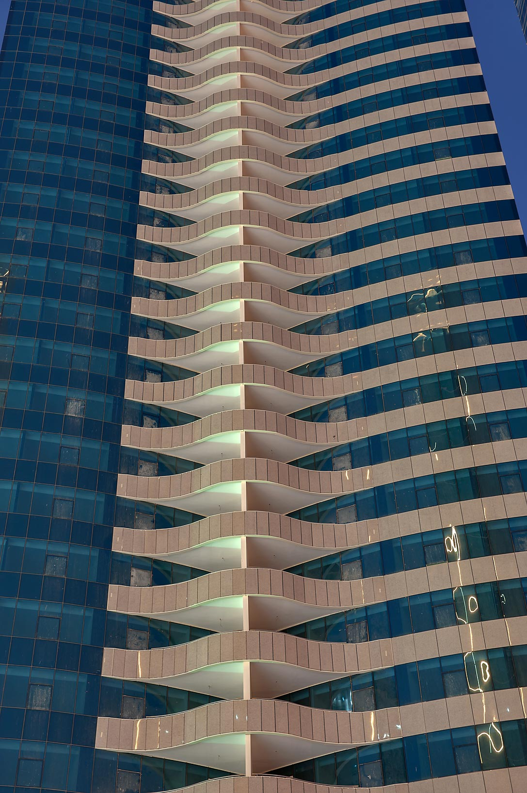 Pattern of balconies on a tower in West Bay, view from Q-Shield Offices St.. Doha, Qatar