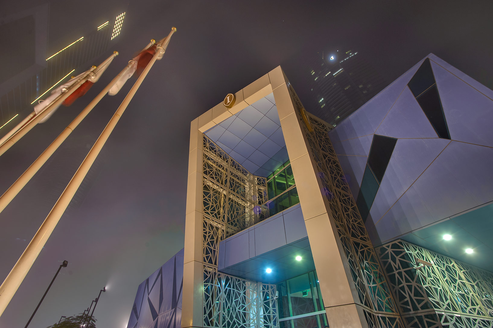 Entrance of Intercontinental Hotel in West Bay in fog. Doha, Qatar