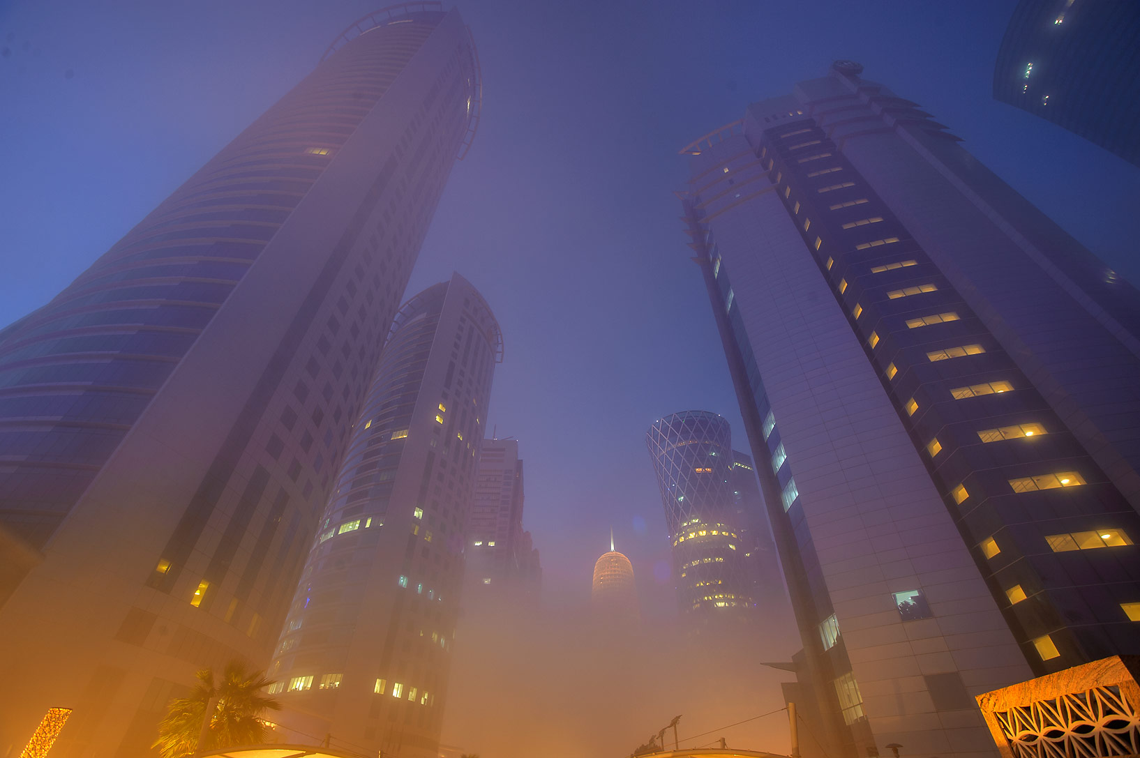 Parking of Al Fardan towers in West Bay in fog at morning. Doha, Qatar
