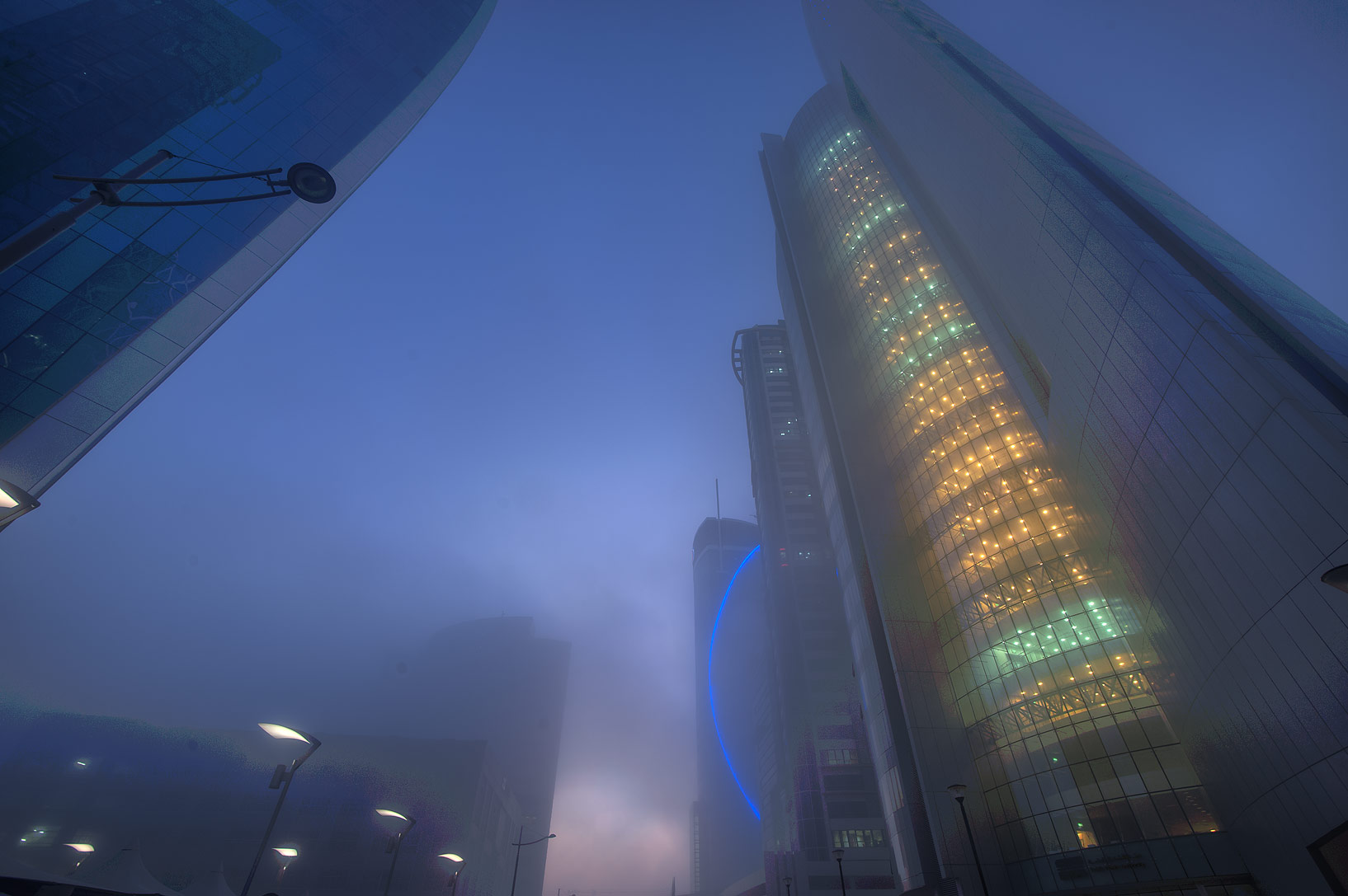 Nakheel Tower in West Bay in fog. Doha, Qatar