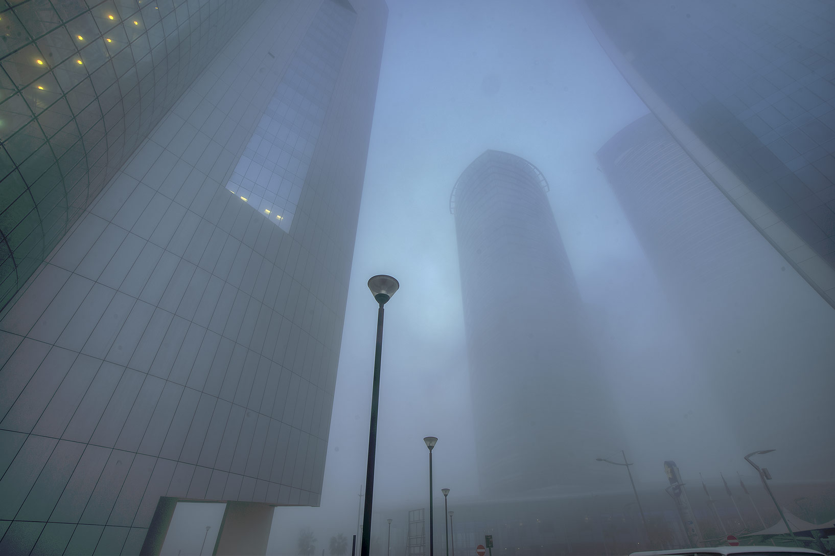 Foot of Nakheel Tower in West Bay in fog. Doha, Qatar