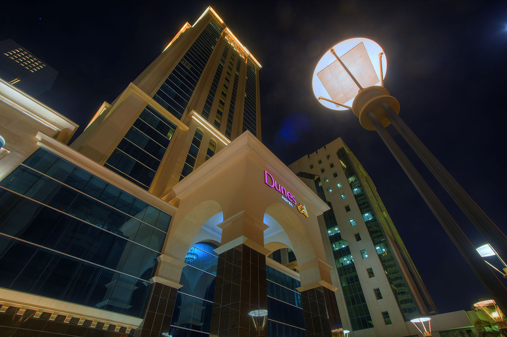 Dunes Hotel in West Bay from Al Shatt St., looking up. Doha, Qatar