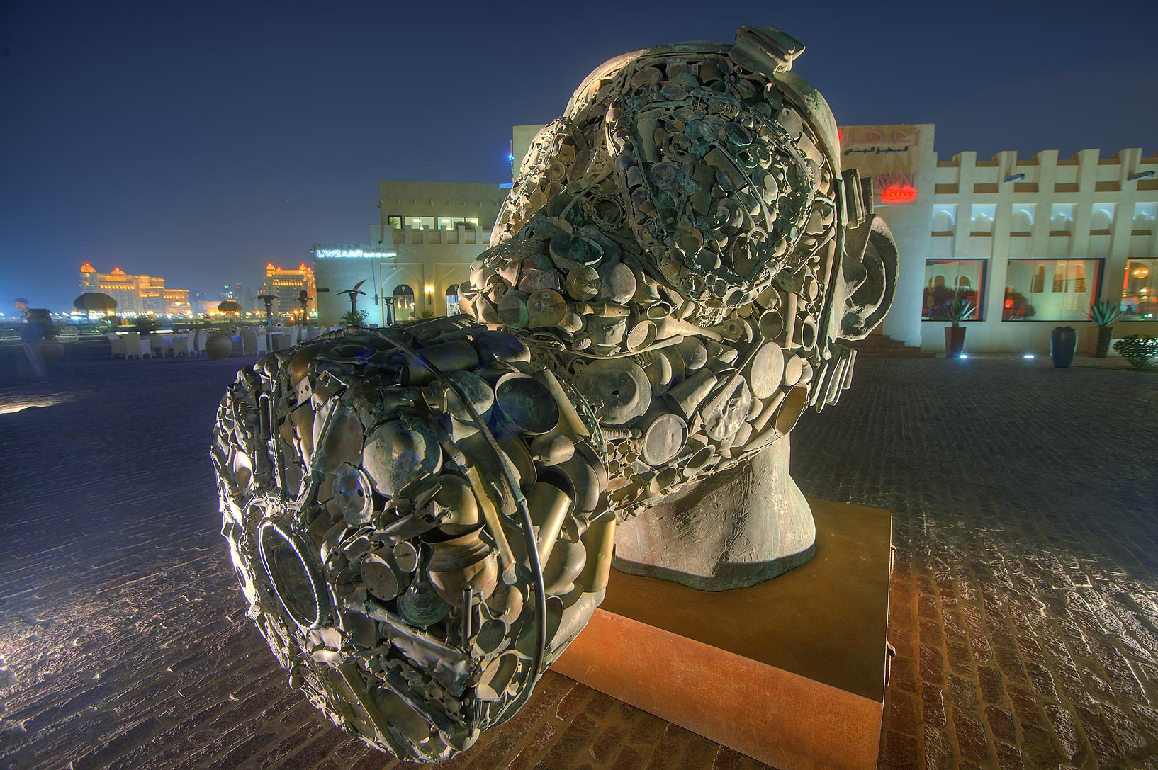 Subodh Gupta's Three Monkeys Sculpture (Mahatma...Village at evening. Doha, Qatar