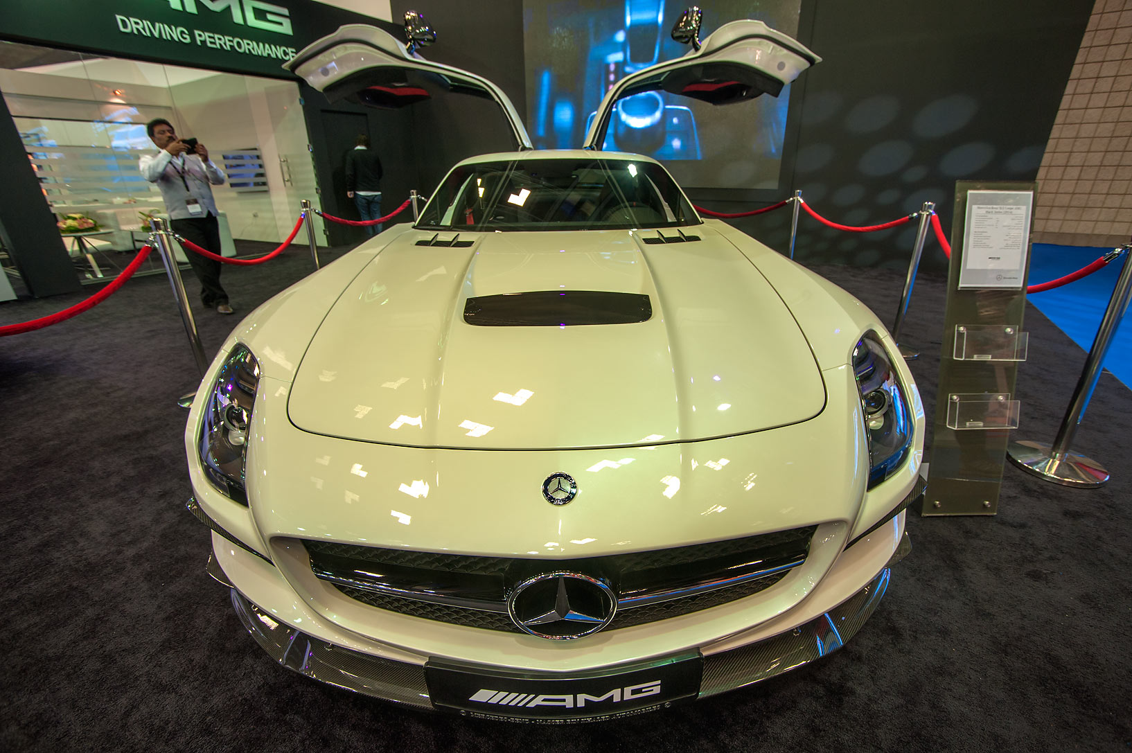 White AMG car on motor show in National Convention Centre. Doha, Qatar