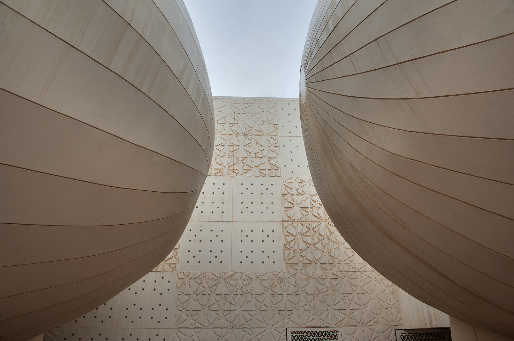 Sides of ovoid lecture halls of Weill Cornell...City campus at rain. Doha, Qatar