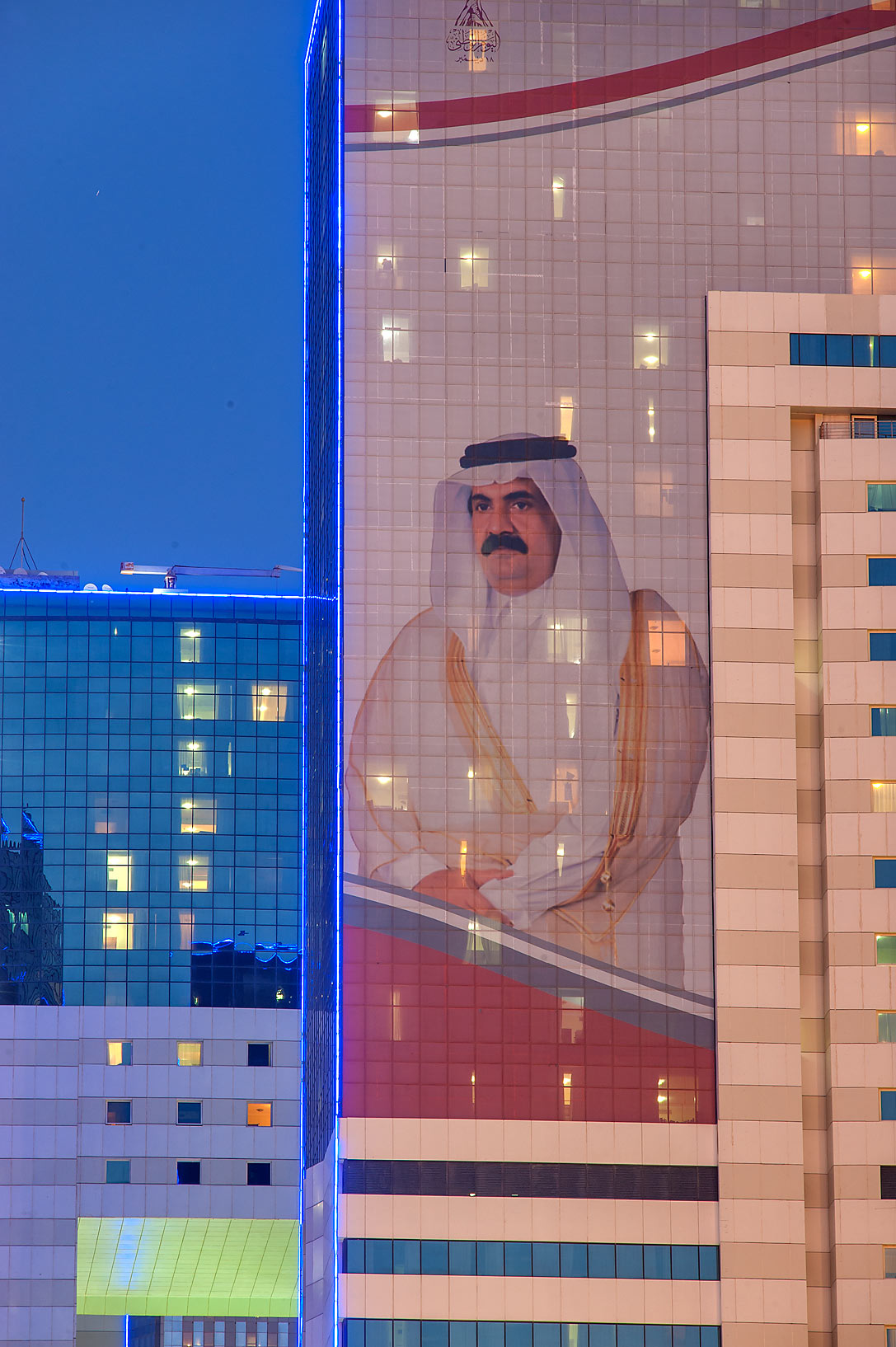 Giant portrait of a former Emir His Highness...Al Adaid St. in West Bay. Doha, Qatar