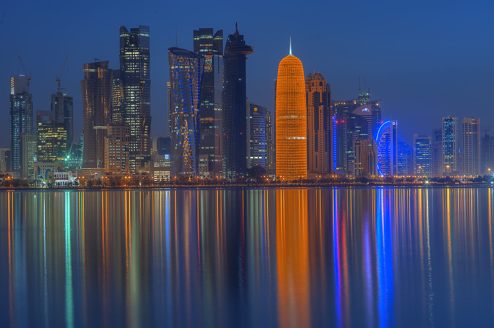 Reflection of towers of West Bay from Corniche promenade. Doha, Qatar