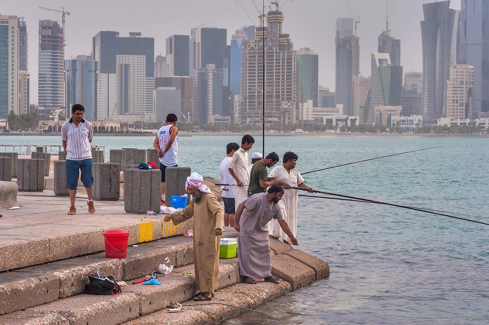 People fishing from Corniche, with West Bay in background. Doha, Qatar