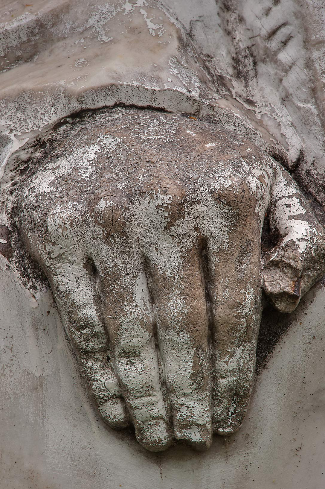 Hand with fingers on a tomb in Communist section...Nevsky Lavra. St.Petersburg, Russia