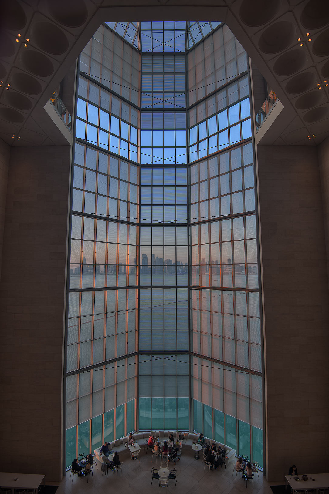 Grand window of Museum of Islamic Art at evening. Doha, Qatar