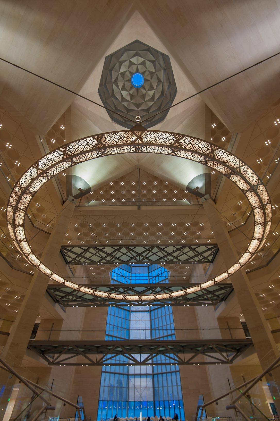 Circular chandelier from ground floor of Museum of Islamic Art at evening. Doha, Qatar