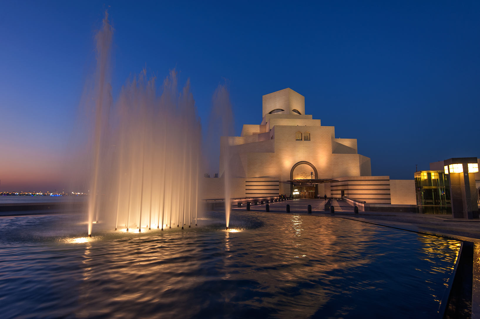 Fountain of Museum of Islamic Art at evening. Doha, Qatar