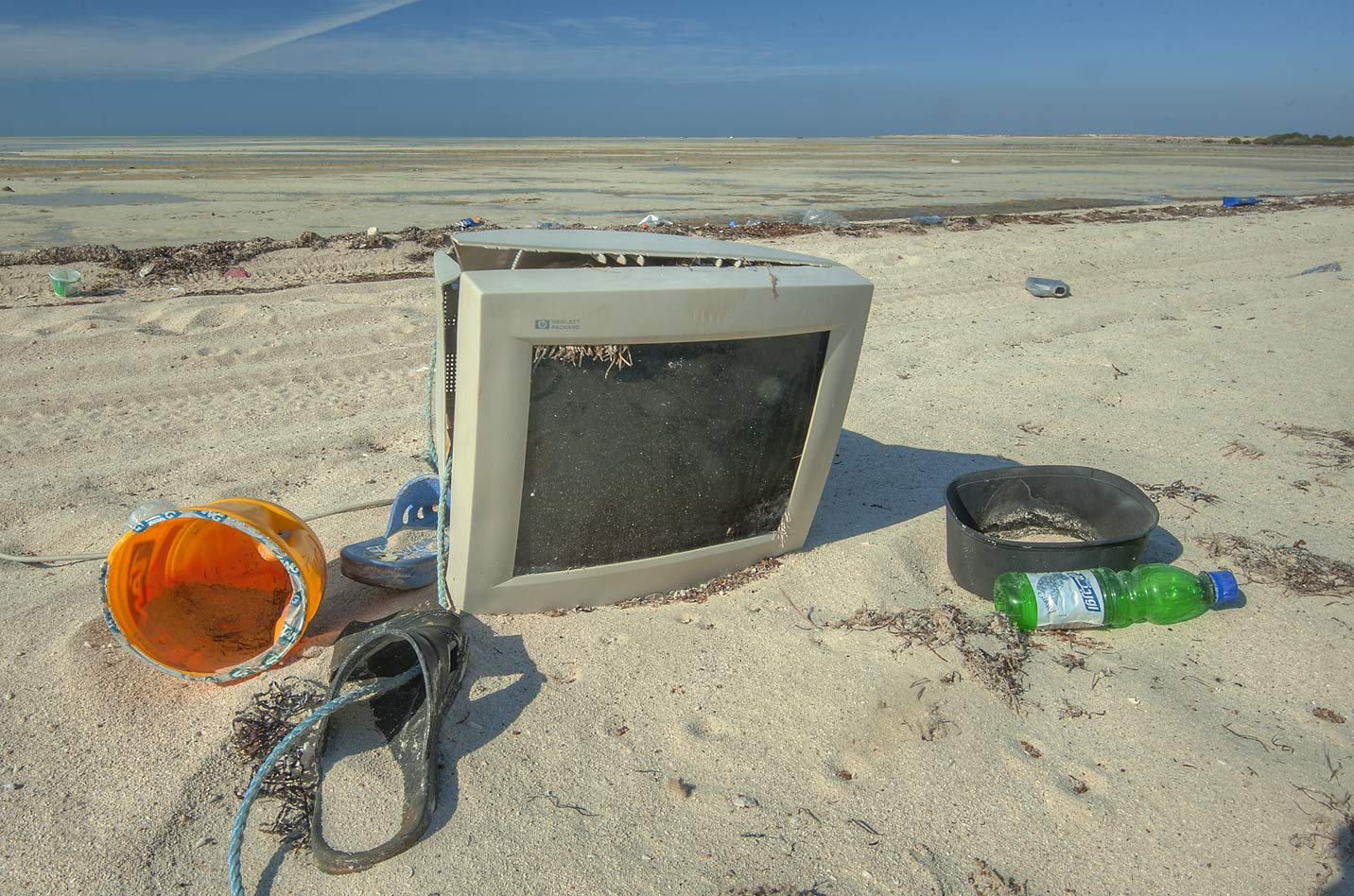 Hewlett Packard computer monitor among trash on a...Jumayl) west of Ruwais. Northern Qatar