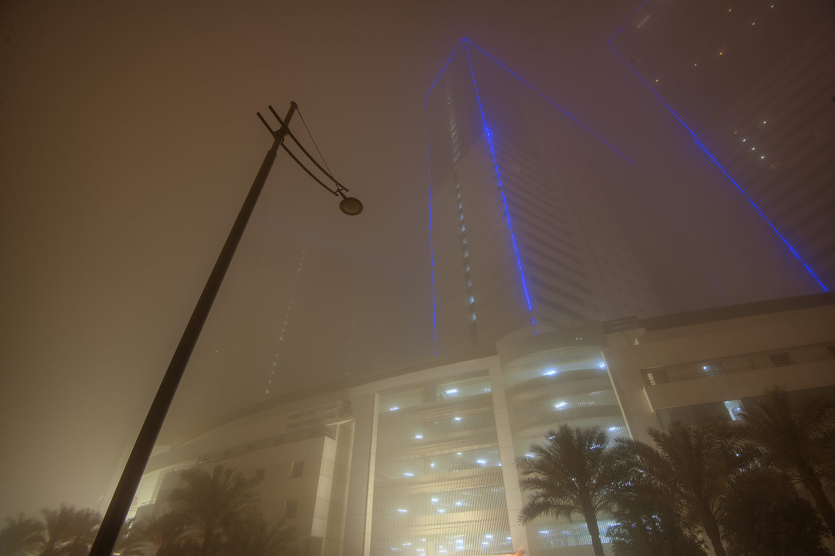Tower No. 3 of Ezdan Hotel and Suites in West Bay during dust storm. Doha, Qatar