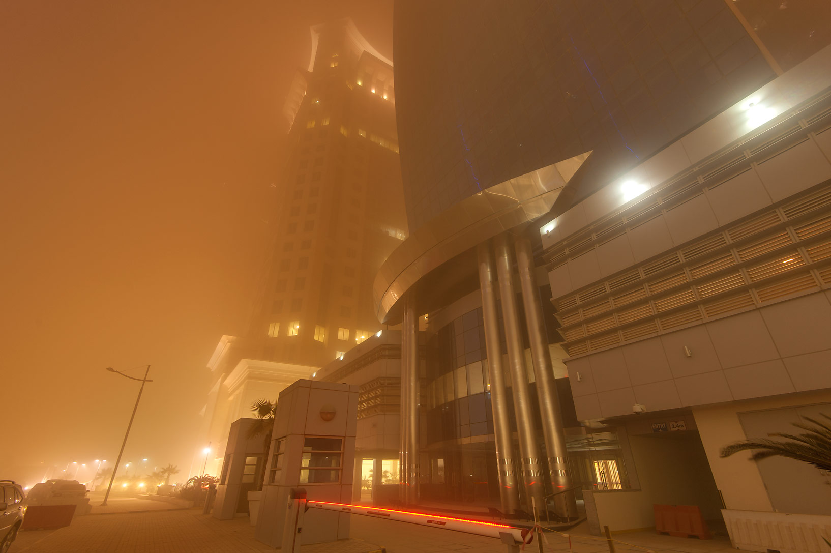 Al Huda Engineering Works Tower in West Bay during dust storm. Doha, Qatar