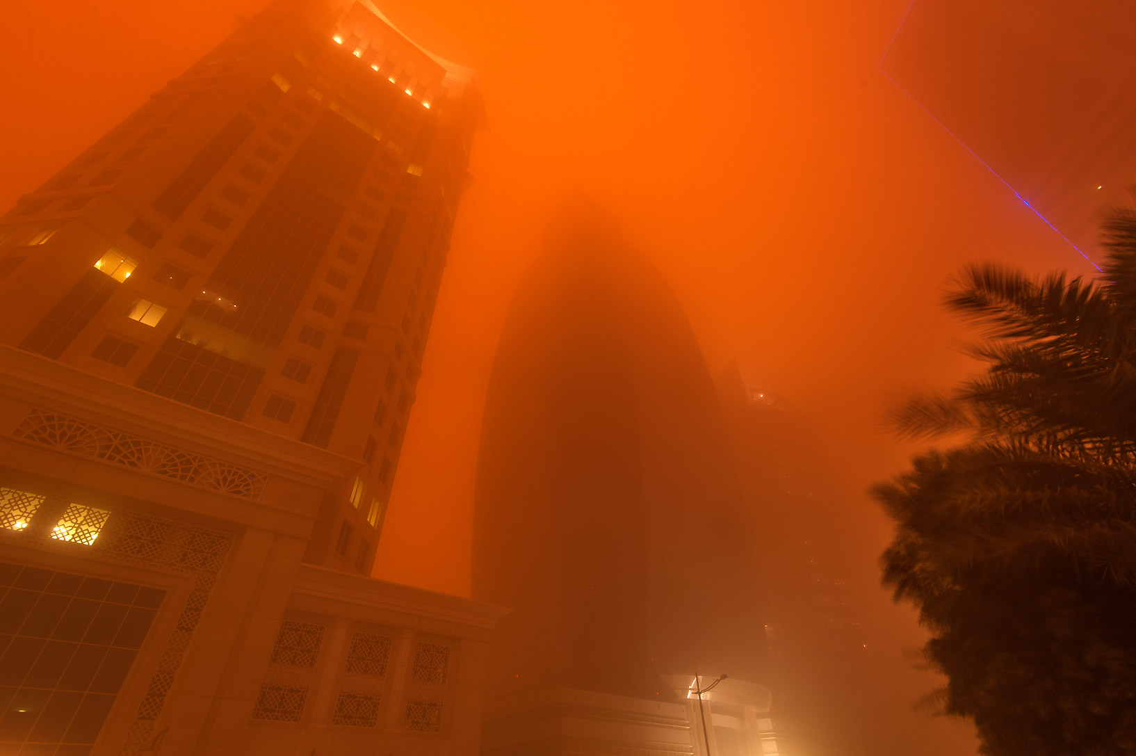 Al Gassar and Al Huda Engineering Works towers in...light from a dust storm. Doha, Qatar
