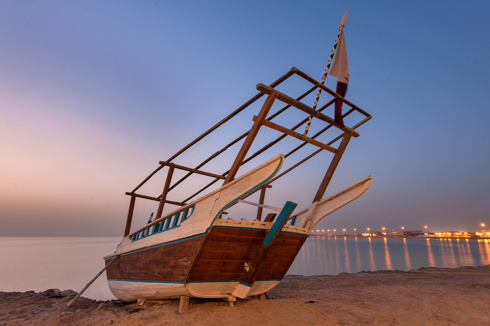 Dhow (fishing boat) on a beach at morning dusk in...Souq Waqif in Al Wakrah). Qatar