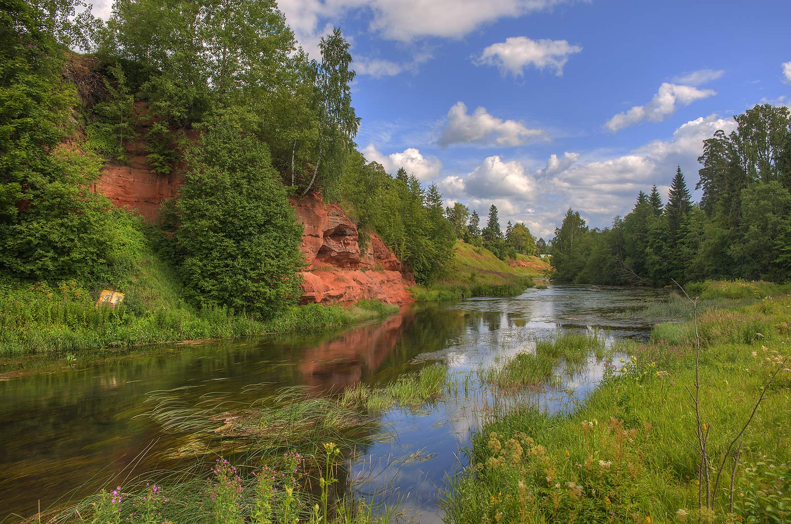 Oredezh River near red sandstone cliffs. Siverskaya south from St.Petersburg, Russia