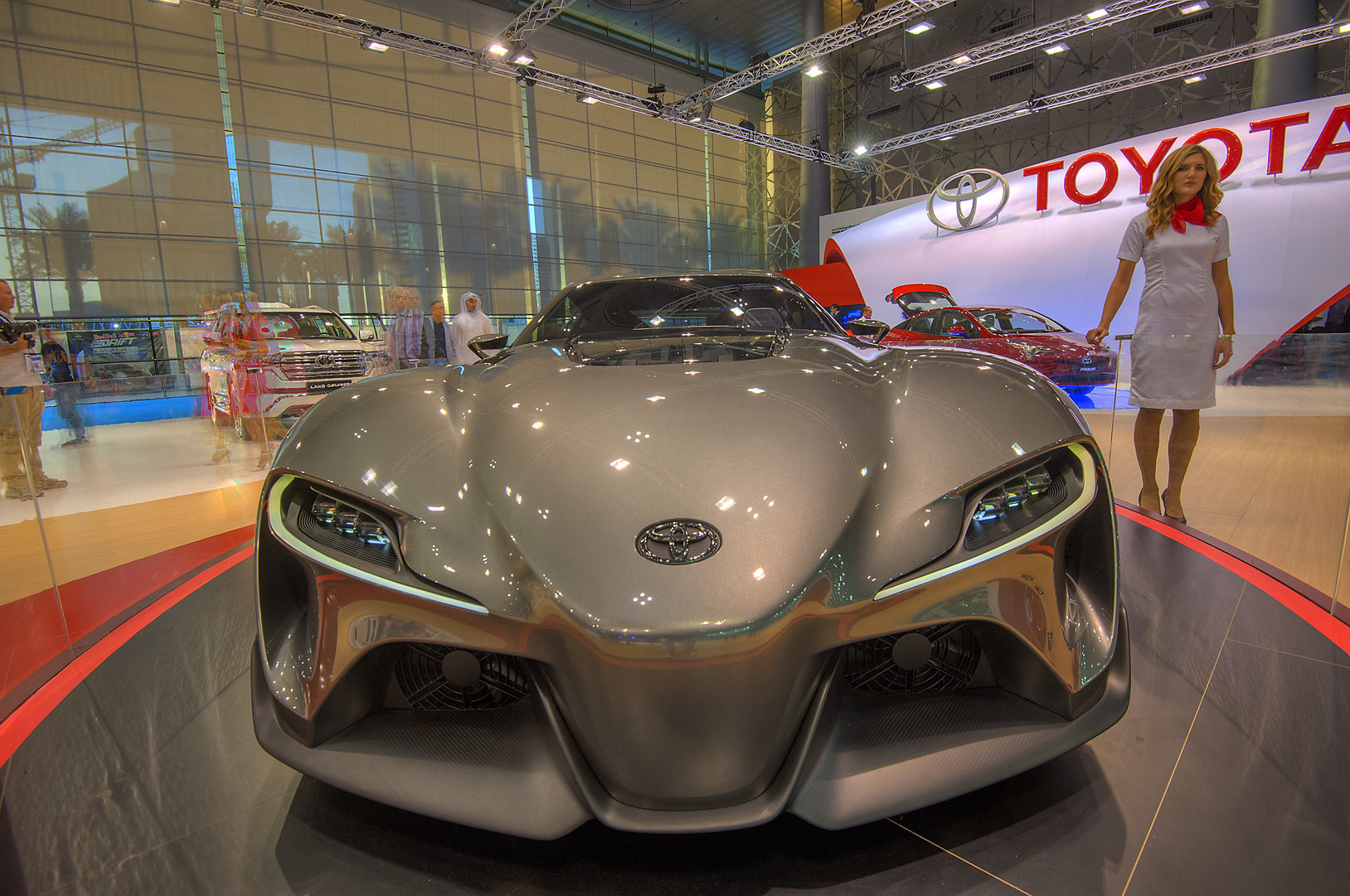 Front view of a silver Toyota car at a motor show...near City Center mall. Doha, Qatar