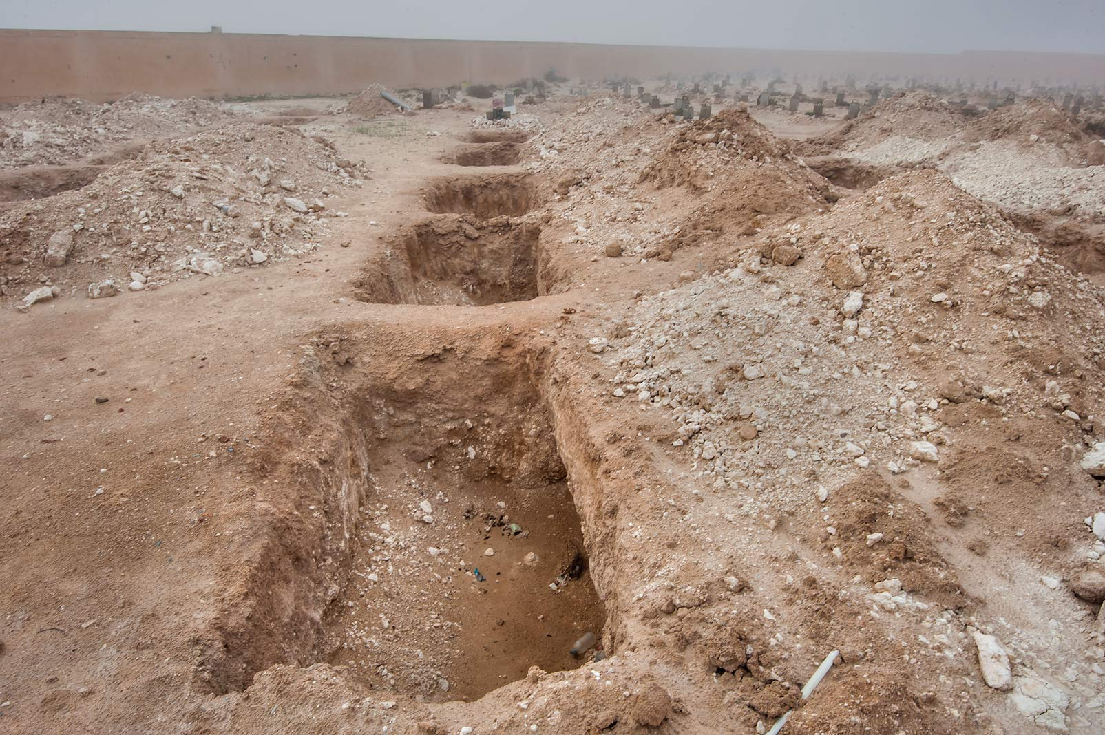 Excavation site in Al Khor Cemetery in mist. North from Al Khor, Qatar