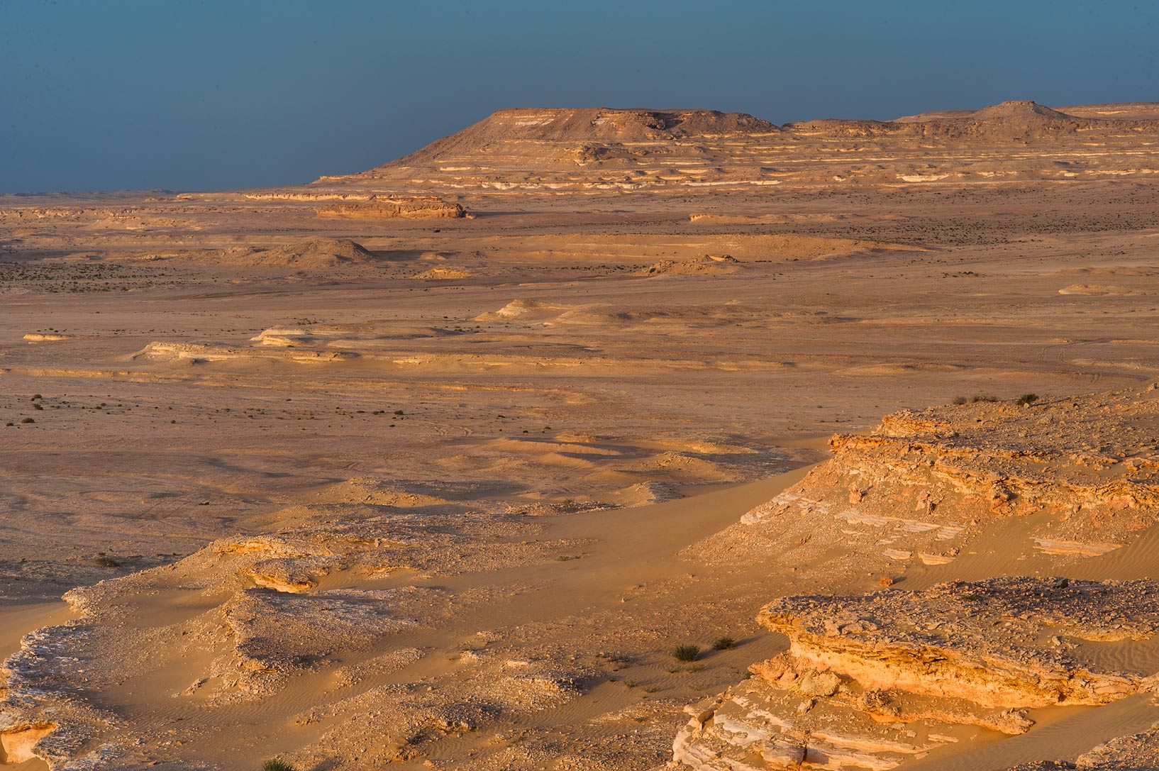 Slopes of Jebel Al-Nakhsh (Khashm an Nakhsh) at sunrise. South-western Qatar