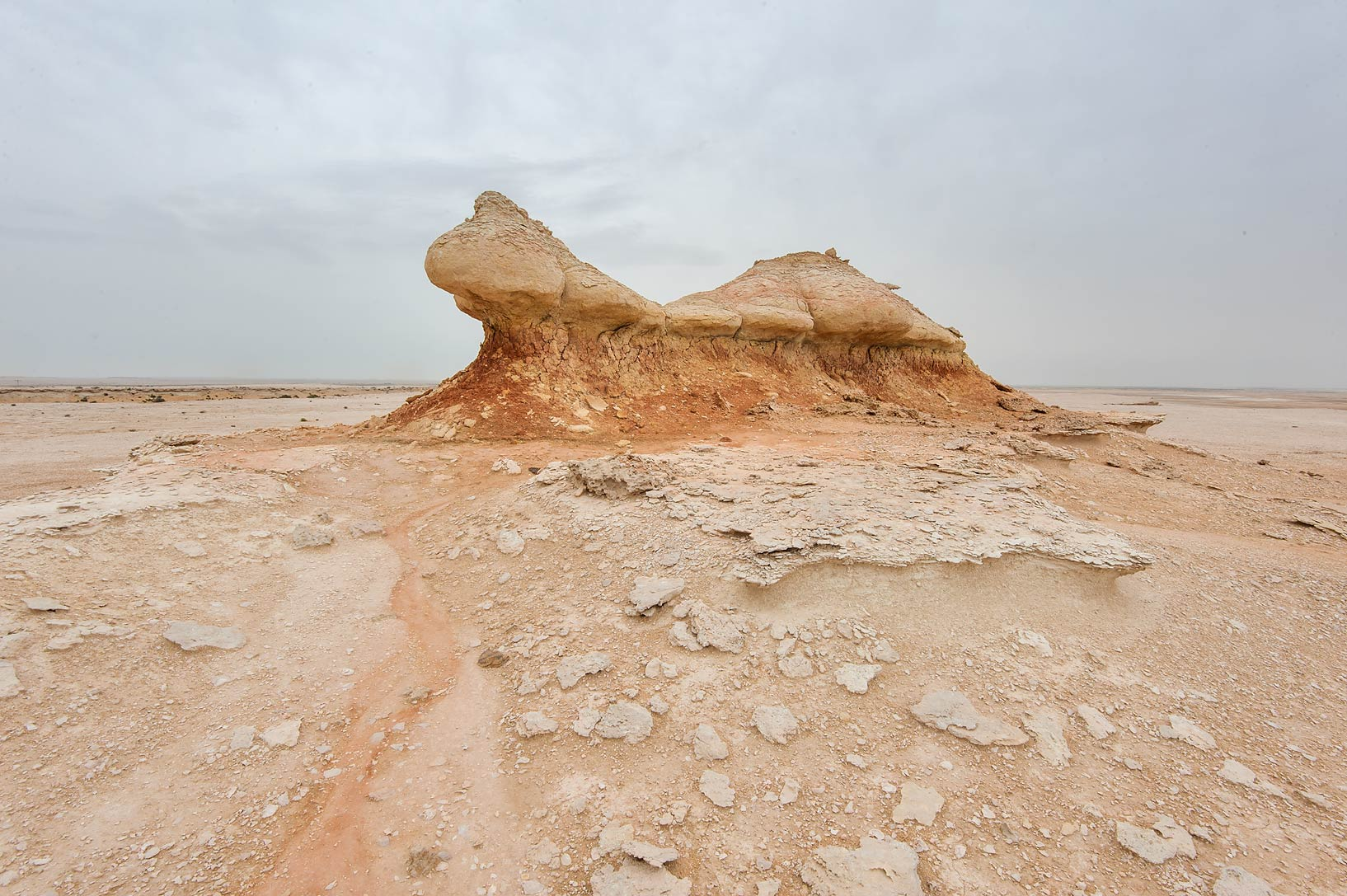 Limestone figure on a plateau of a tabletop...Reserve near Abu Samra. Southern Qatar