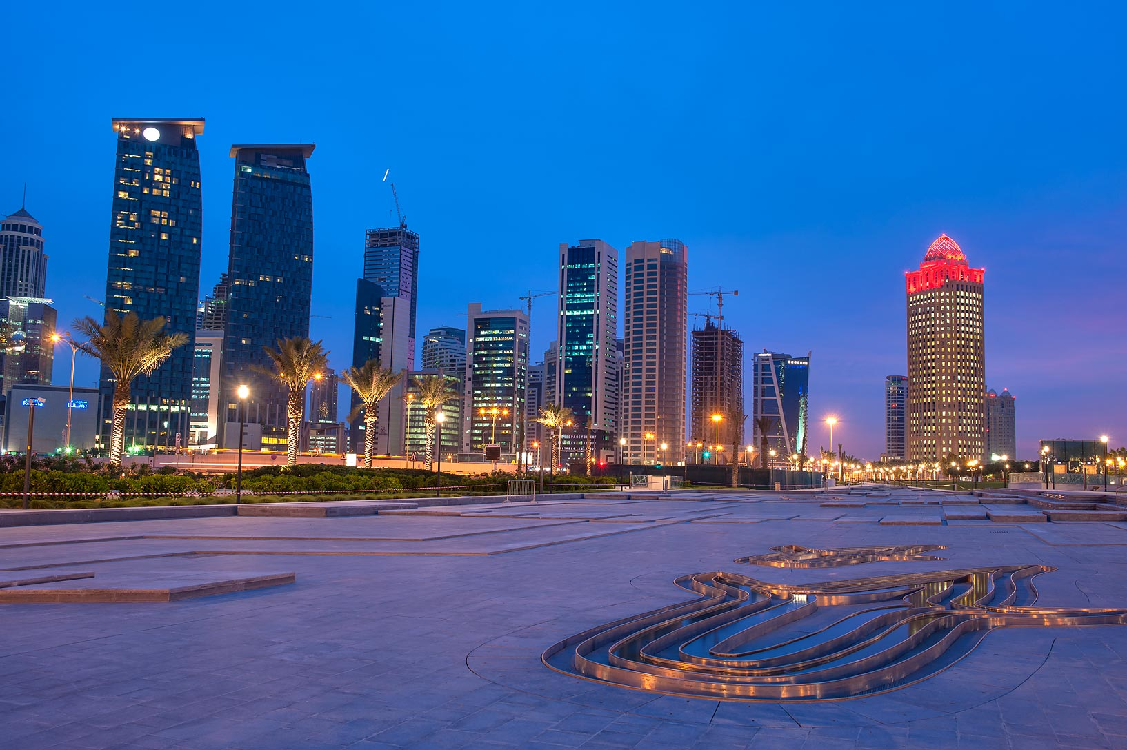 Fountain below Sheraton Hotel at dusk. Doha, Qatar
